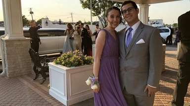 Jamie Macias, right, hangs out with his date,