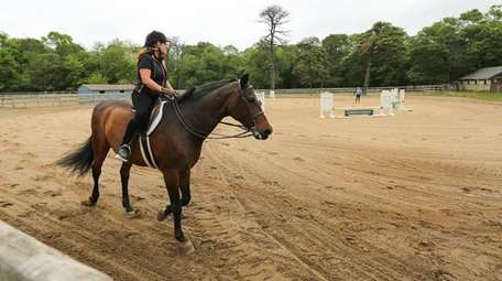 A woman rides a horse at Parkview Riding