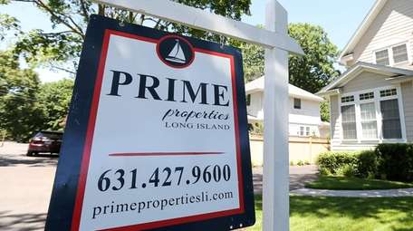 A Prime Properties Long Island sign during an