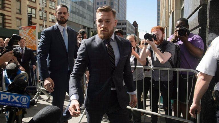 Conor McGregor exits Brooklyn Supreme Court after a