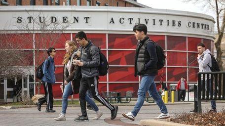 Students walk through Stony Brook University's campus on