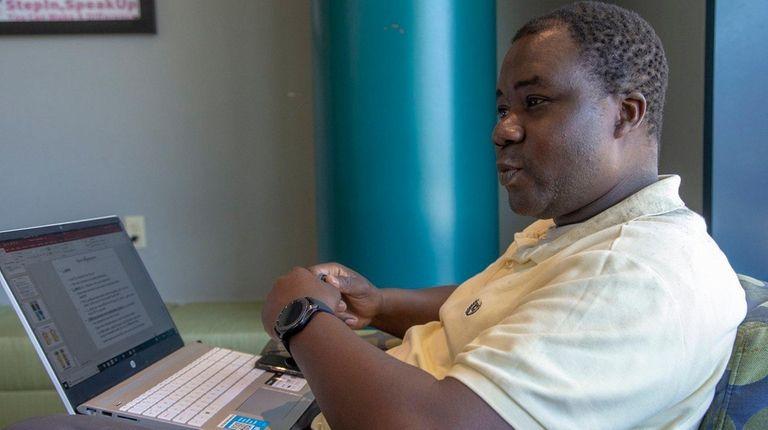Wilfred Zulu, Elmont, speaks about SUNY raising its