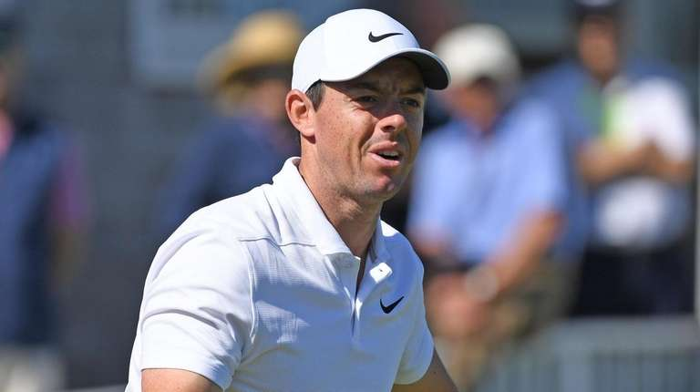 Rory McIlroy reacts on the 14th hole during