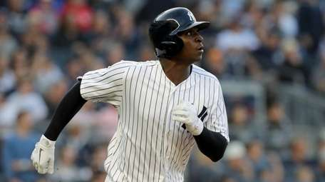 Didi Gregorius of the Yankees watches the flight