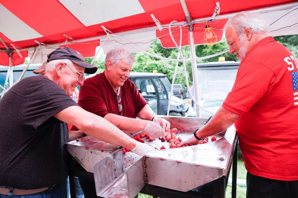 Lion Club members wash the berries at the