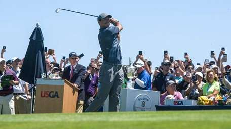 Tiger Woods tees off during the first round