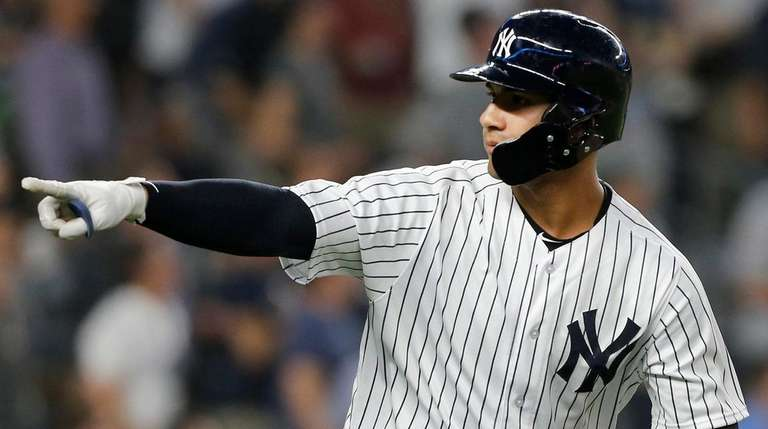 Yankees second baseman Gleyber Torres reacts after hitting
