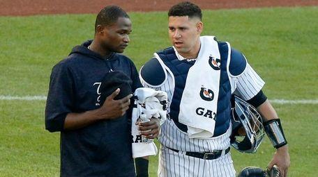 Yankees catcher Gary Sanchez talks with starting pitcher