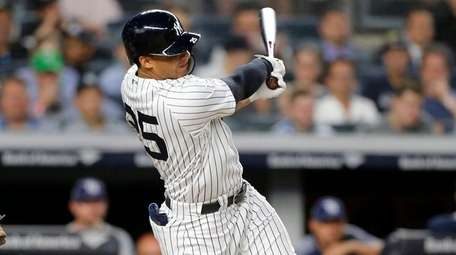 Yankees' Gleyber Torres follows through on three-run home