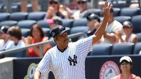 Former New York Yankees player Ron Guidry waves