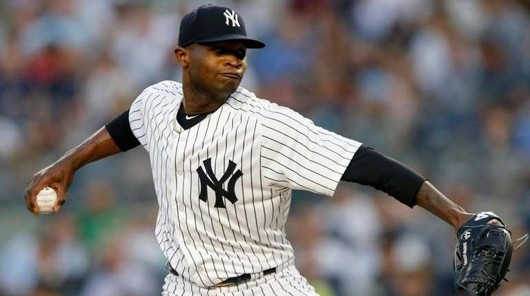 Yankees pitcher Domingo German delivers against the Rays
