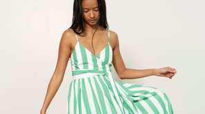 An airy awning-stripe sundress, $325, at Love Adorned
