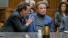 """John Travolta, right, and Chris Kerson in """"Gotti."""""""
