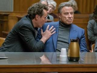 "John Travolta, right, and Chris Kerson in ""Gotti."""