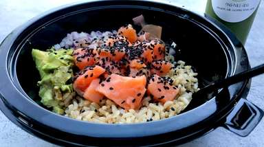 A salmon and brown rice poke bowl at