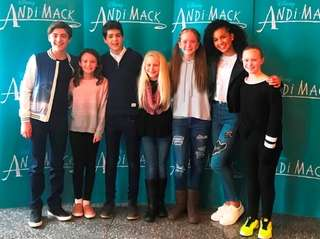Kidsday reporters with cast members from the Disney