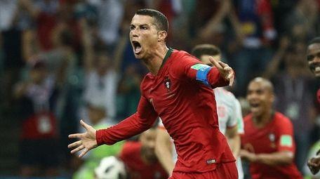 Cristiano Ronaldo of Portugal celebrates after scoring his