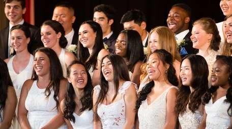 Graduates sing during The Waldorf School commencement Friday.