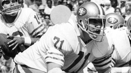 San Francisco 49ers tackle Keith Fahnhurst blocks for