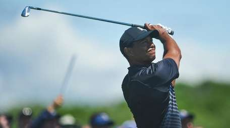 Tiger Woods tees off on seven during the