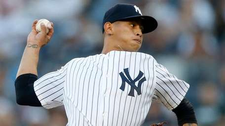 Jonathan Loaisiga of the Yankees pitches in the