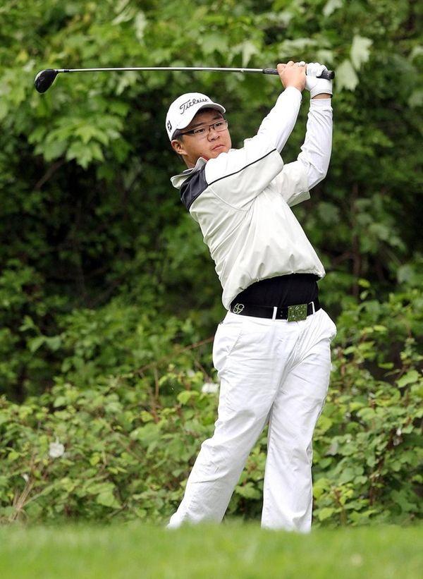 Smithtown's Jim Liu, 14, tees off on the