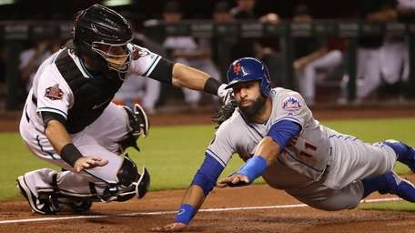Jose Bautista of the Mets is tagged out