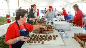Lions club volunteers work on chocolate dipped strawberries
