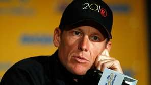 Lance Armstrong speaks to the media. (May 14,