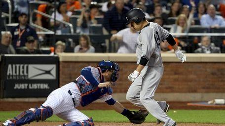Yankees pitcher Masahiro Tanaka scores a run past