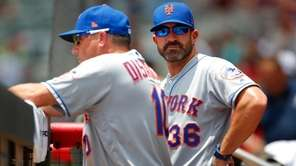 Mets manager Mickey Callaway watches on alongside bench