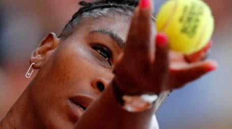 Serena Williams serves against Julia Georges during their