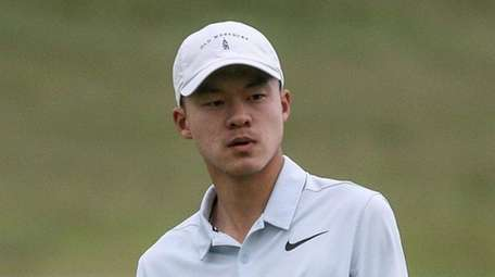 Adam Xiao of Manhasset watches his putt on