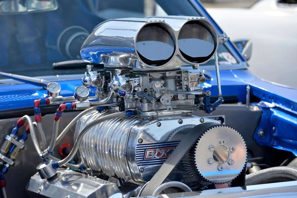 A highly modified engine on a Chevy Camaro.