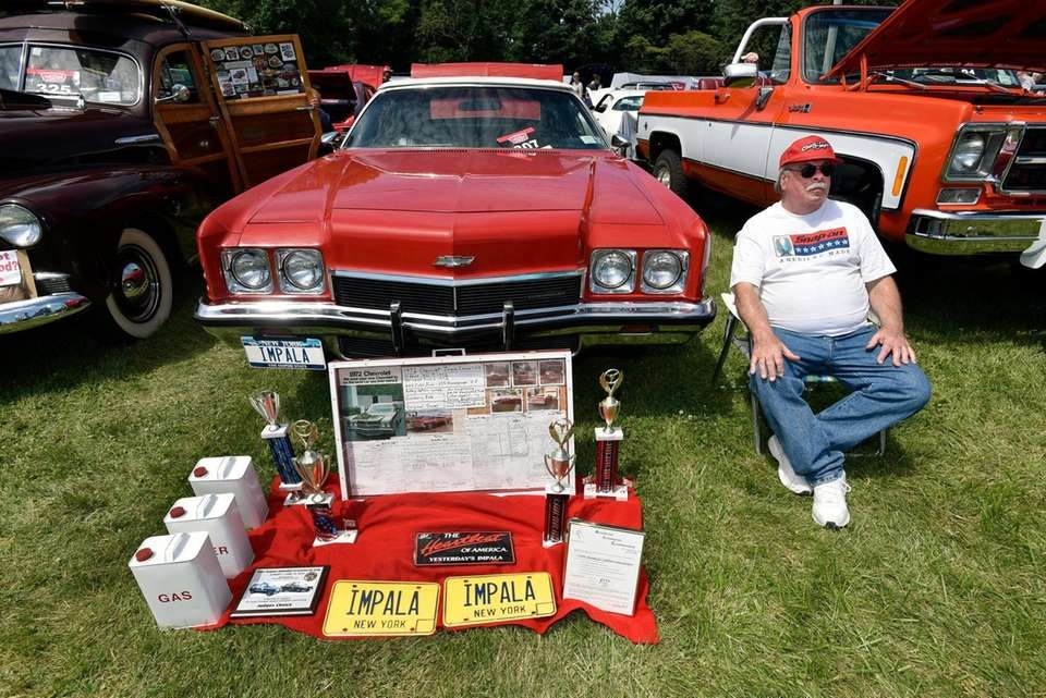 Tom Donahue sits by his 1972 Chevy Impala