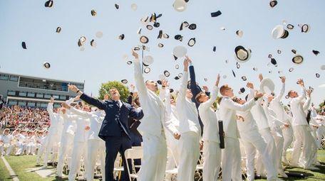Graduates send their caps skyward during the U.S.