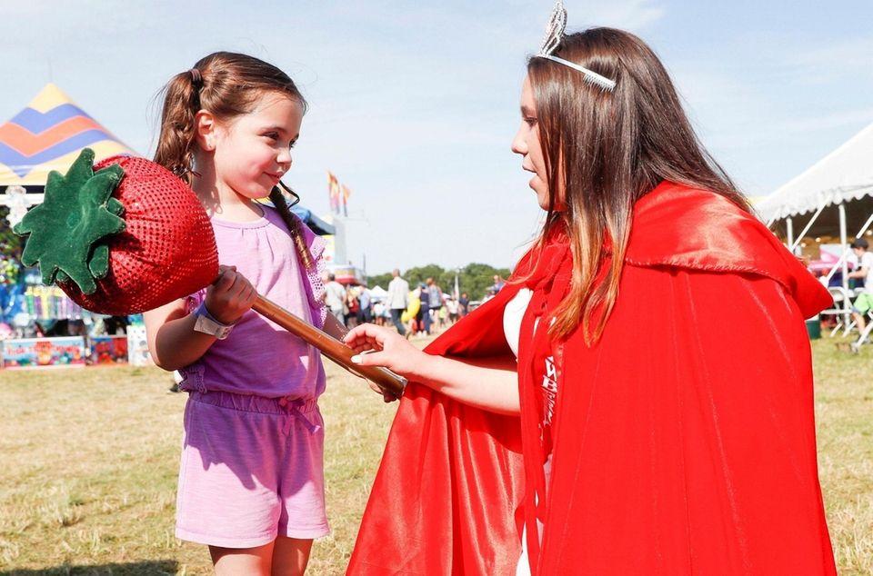 Strawberry Queen Teagan Nine, 16, of Mattituck meets