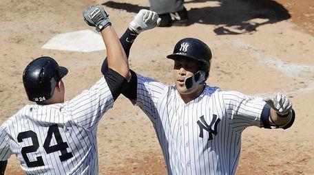 Yankees left fielder Giancarlo Stanton and Yankees catcher