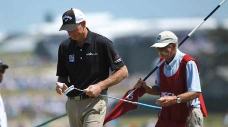 Jim Furyk on the 3rd hole with his