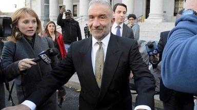 Former SUNY Polytechnic Institute President Alain Kaloyeros, center,