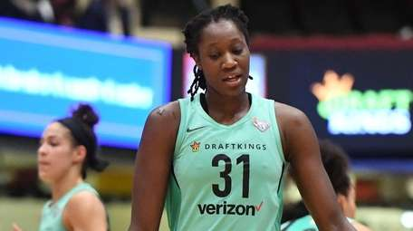 Liberty center Tina Charles reacts against the Connecticut
