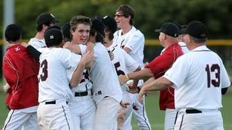 Friends pitcher Edward McNelis (24) is mobbed by