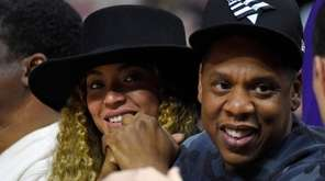 Beyonce and Jay Z watch during the first