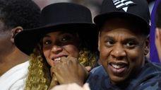 Beyoncé and Jay-Z at an NBA basketball game