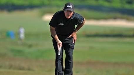 Phil Mickelson eyes the shot on the 4th