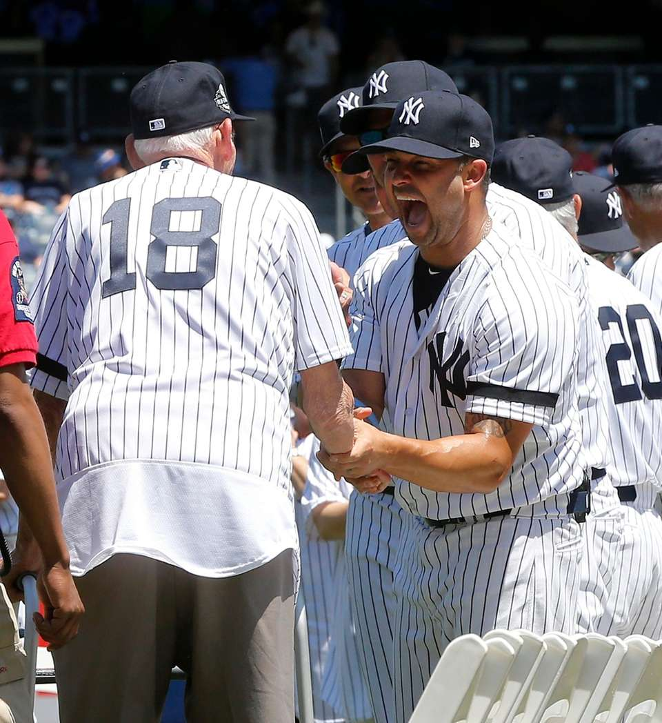 Nick Swisher greets Don Larsen during Old-Timers' Day