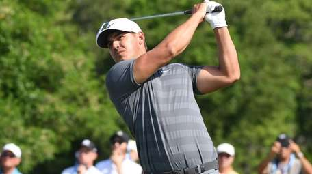 Brooks Koepka tees off at the 10th at