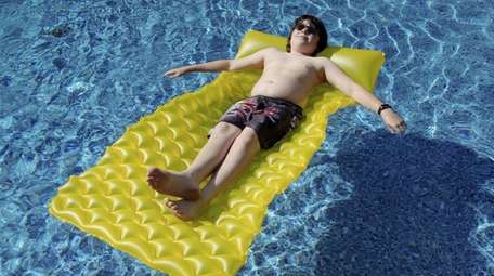 Jonathan DiMarco, 12, of Manorville, cools off in