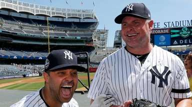 Nick Swisher has a laugh with Jason Giambi