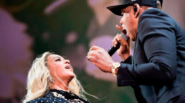Beyoncé and Jay-Z perform during a Get Out